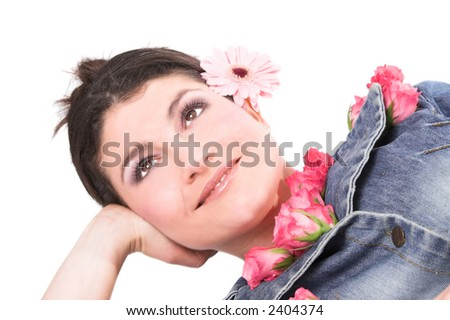 beautiful brunette with a daisy behind her ear and roses tucked in her shirt - stock photo