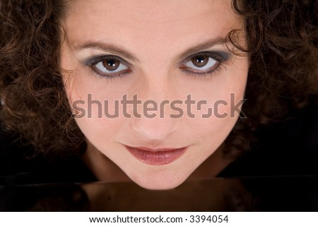 beautiful brunette with a very sexy brooding look in her eyes - stock photo