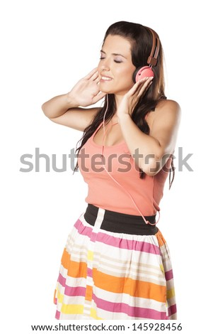 beautiful brunette with blue eyes and headphones on her head enjoys music