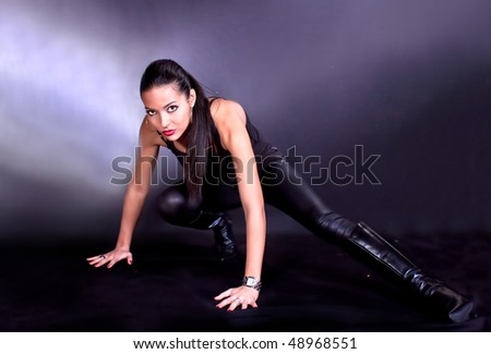 Beautiful brunette with  brown eyes posing, studio shot