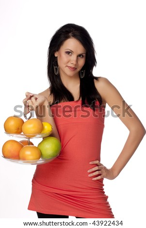 beautiful brunette with citrus on a white background - stock photo