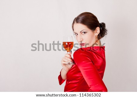 Beautiful brunette with glass of red wine - stock photo