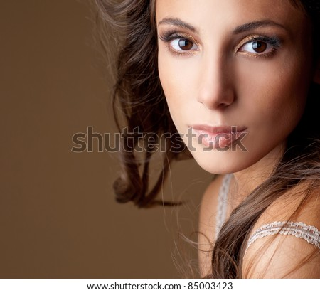 beautiful brunette with gorgeous hair - stock photo