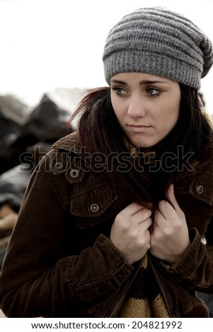 Beautiful brunette with hat and jacket sad