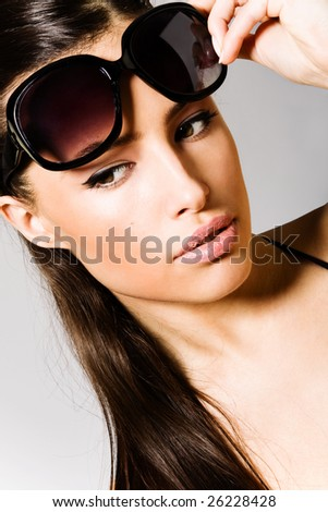 beautiful brunette with sunglasses portrait - stock photo