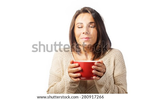 beautiful brunette woman a drink hot beverage from red cup on white background  - stock photo