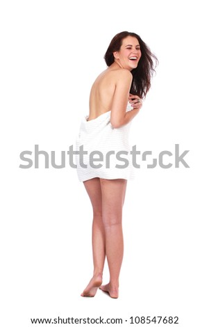 Beautiful brunette woman at day spa in white towel naked before shower or a treatment or massage - stock photo