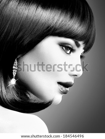 Beautiful Brunette Woman. Bob Haircut. Fringe Hairstyle. Short hair. Fashion Model Girl with beauty diamond earrings. Perfect Makeup. Make up. Black and White portrait - stock photo