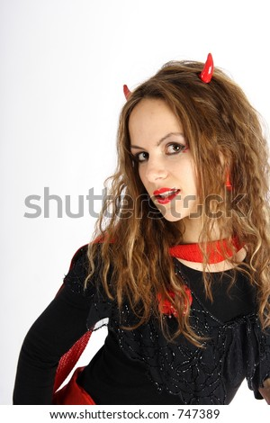 Beautiful brunette woman dressed like a red devil