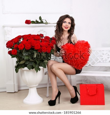 Beautiful Brunette Woman Holding Red Heart Over Bouquet Of Roses. Valentine  Girl. Beauty Glamour