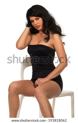 Beautiful brunette woman in a strapless black dress - stock photo