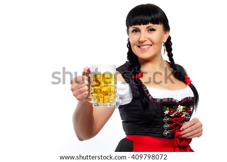 Beautiful brunette woman in Bavarian dressed with glass of beer