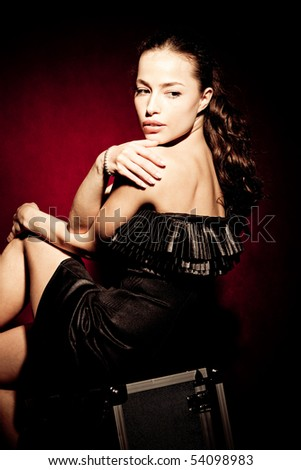 beautiful brunette woman in elegant dress, studio shot - stock photo