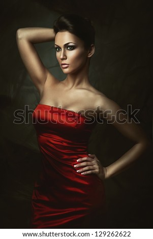 beautiful brunette woman in red dress - stock photo