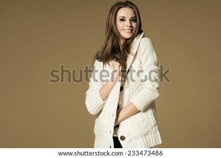 Beautiful brunette woman in studio - stock photo