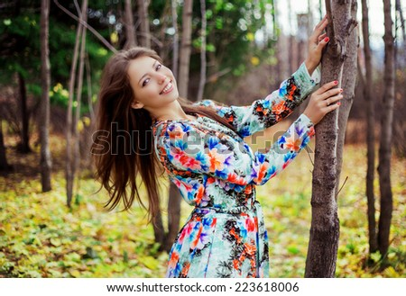beautiful brunette woman in the autumn park - stock photo