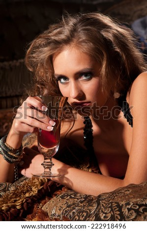 beautiful brunette woman lying on a fur mat - stock photo
