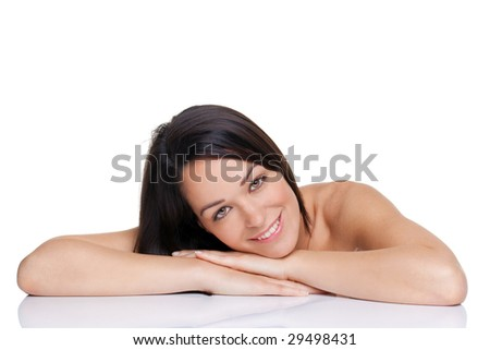 Beautiful brunette woman lying with her face on her hands, isolated on white background. - stock photo