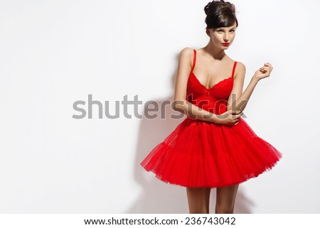 Beautiful brunette woman posing in red dress. Valentines - stock photo