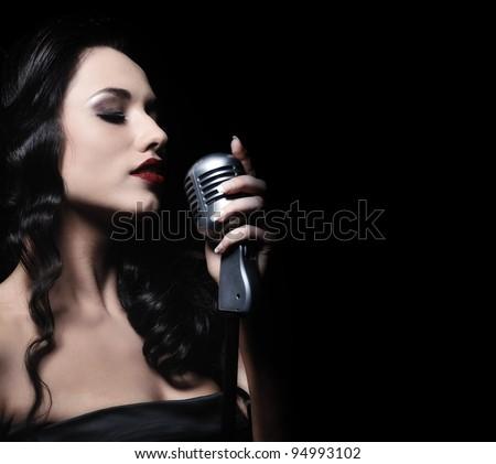 Beautiful brunette woman singing - stock photo