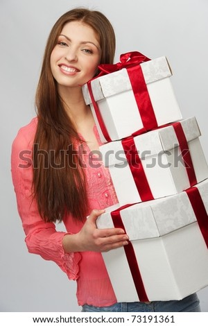 Beautiful brunette woman with a gift boxes - stock photo