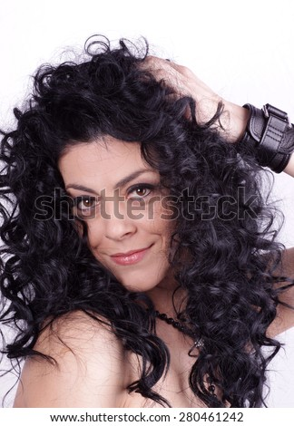Beautiful brunette woman with beauty long curly hair. Fashion model - stock photo