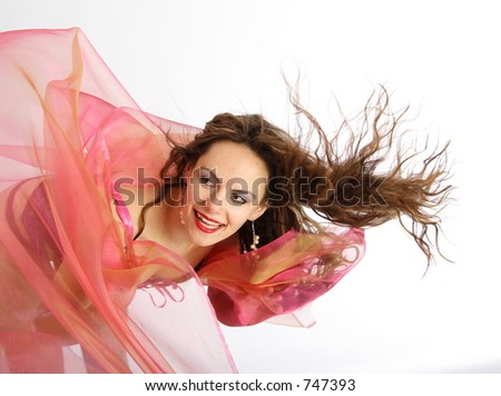 Beautiful brunette woman with blowing hairs and foulards - stock photo