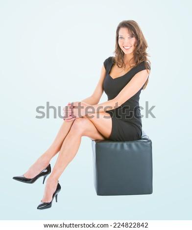 Beautiful brunette woman with elegant black dress, studio shot, isolated - stock photo