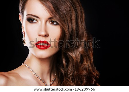beautiful brunette woman with evening make up and hairstyle