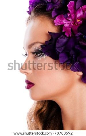 beautiful brunette woman with flowers in hair