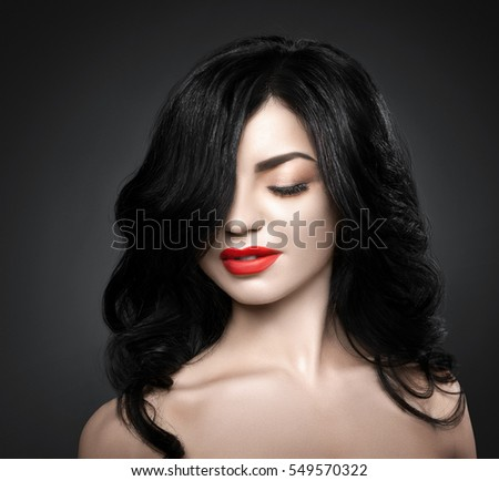 Beautiful brunette woman with shot hairstyle and sexy red lips.
