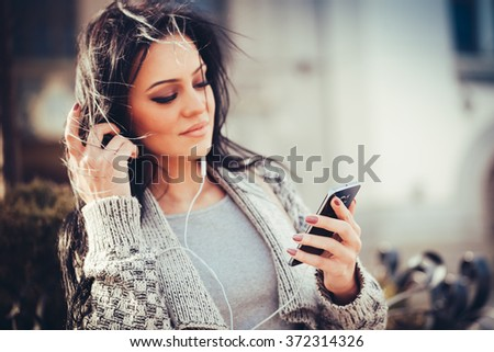 beautiful brunette woman with  smart phone