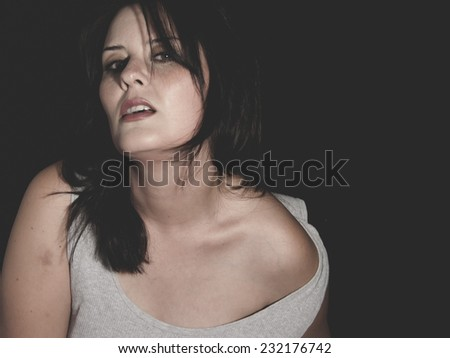 Beautiful brunette woman with white dress Spanish origin, sensuality - stock photo