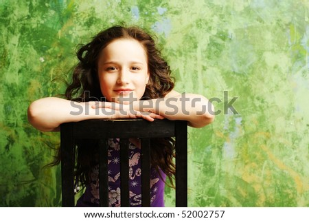 beautiful brunette young teen girl sitting on chair posing - stock photo