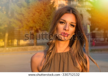 Beautiful brunette young woman.Lens flare - stock photo