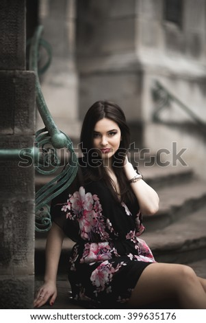 Beautiful brunette young woman posing on the street in old city