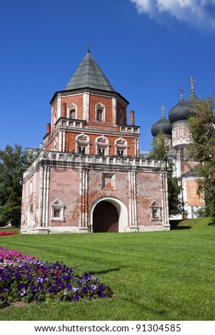 Beautiful building.Mostovaya tower against the blue sky and green grass. The Tsar's estate in Izmailovo. Russia, Moscow - stock photo