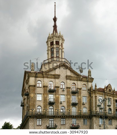 Beautiful building with a spike in Kiev in the street a Khreschatik - stock photo