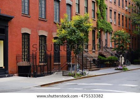 brick apartment building entrance. Beautiful buildings in Greenwich Village  Soho district Entrance doors with stairs and trees Buildings District Stock Photo