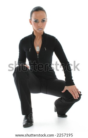 Beautiful Bulgarian woman squatting on white floor. - stock photo