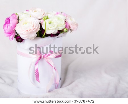 beautiful bunch of summer flowers in round box over white background - stock photo