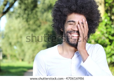 Beautiful business man with afro outside