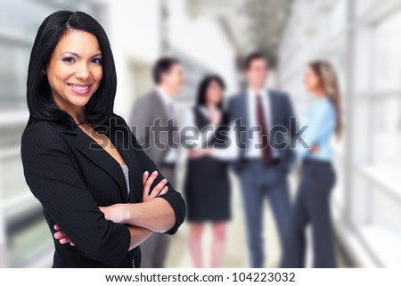 Beautiful business woman and a group of person. - stock photo