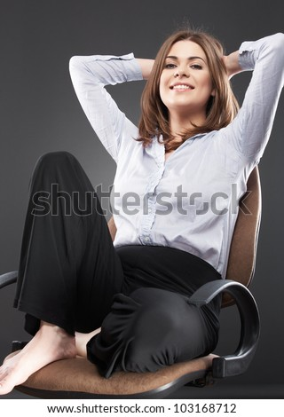 Beautiful business woman [ bank employee ] portrait sitting in chair. Relaxing female office worker - stock photo