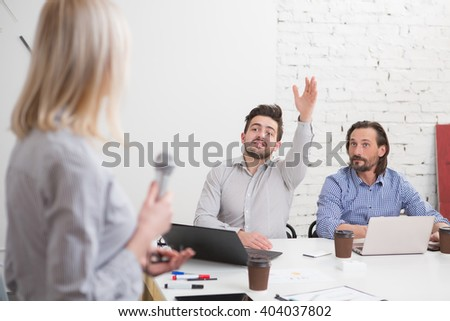 Beautiful business woman doing presentation to her colleagues men about new business strategy in company or firm. - stock photo