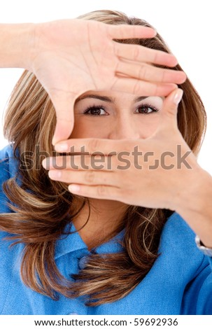 Beautiful business woman framing her face - isolated over a white background