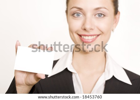 Beautiful business woman holding a blank card - stock photo