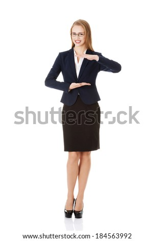 Beautiful business woman holding empty copy space between her hands. Isolated on white.