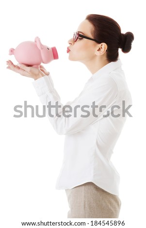 Beautiful business woman holding piggy-bank. Isolated on white.