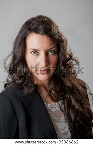 Beautiful business woman in a blue suit - stock photo